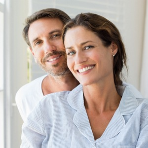 A man and woman smiling