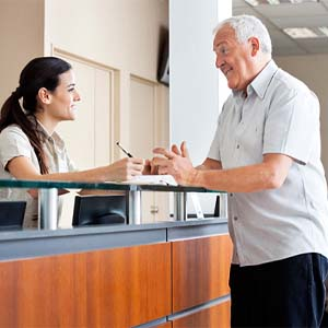 An older couple examining a dental X-ray.