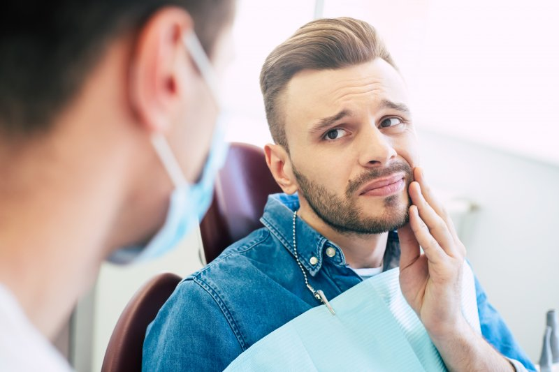 Patient visiting dentist about tooth pain