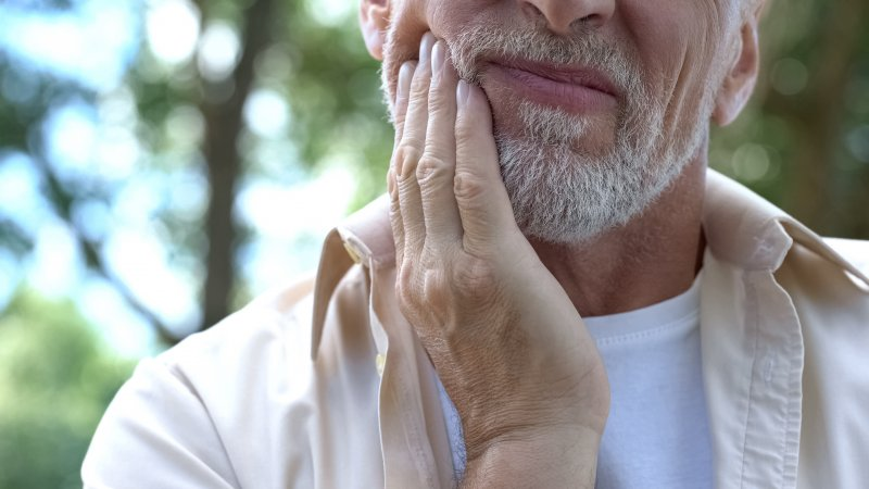 Closeup of senior man with oral pain