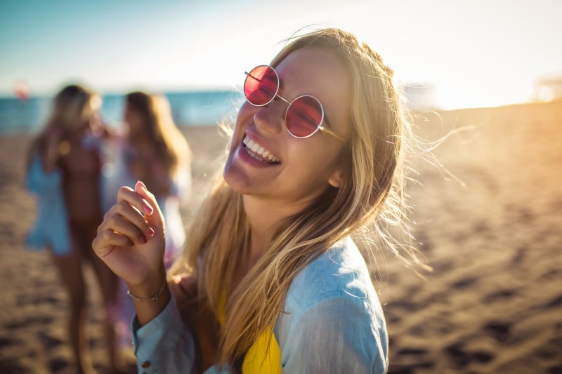 girl smiling on beach during summer vacation